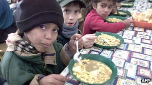 Children receiving government food aid at a state school in July 2002