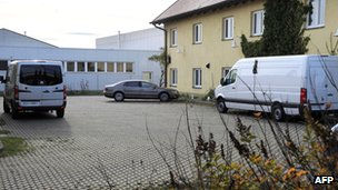 Picture taken on 17 October 2012 shows vans in the courtyard of a funeral parlour in Hoppegarten, east of the German capital, Berlin.