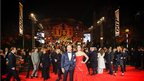 Daniel Craig and new bond girl Berenice Marlohe pose on the red carpet outside the Royal Albert Hall in London.