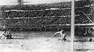 Uruguay score a goal in their 4-2 defeat of Argentina in the 1930 World Cup final in Montevideo