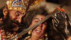 In this 21 October photo, artists prepare before going on stage for a traditional Ramlila drama