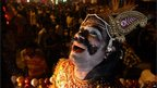 An artist performs during a Dussehra festival procession in Allahabad on 22 October 2012