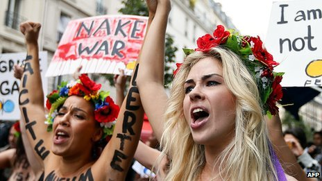Topless activists from Ukraine&#039;s Femen group protest in Paris