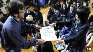 A Japanese girl getting her graduation certificate