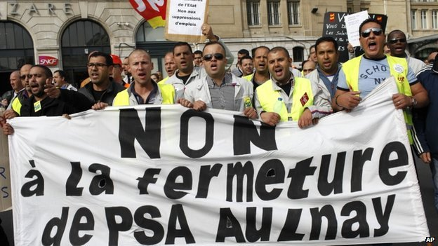 PSA Peugeot Citroen workers in street protest against planned job cuts and factory closure