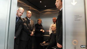 German chancellor Angela Merkel and others in a lift, 2010
