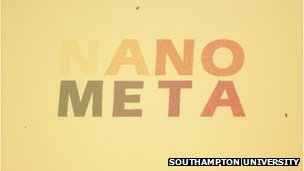 A piece of gold with the words Nano Meta written on it in colours