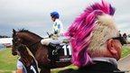 Darryn Lyons watches horses