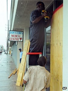 Boarding up windows in the capital Kingston