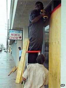 Boarding up windows in the capital Kingston
