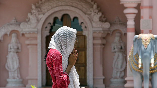 Hindu worshipper prays at a temple in Trinidad and Tobago