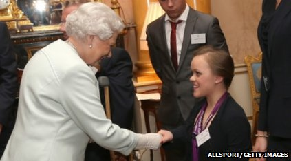 The Queen shakes hands with swimmer Ellie Simmonds