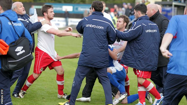 Linfield and Dungannon players clash after a 1-1 draw at Stangmore Park