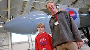 Matthew and Bill Beton stood in front of the Vulcan Bomber