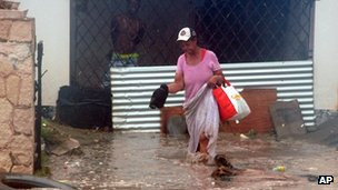 Woman walks through floodwater in Kingston, Jamaica (24 Oct 2012)