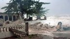 Waves, brought by Hurricane Sandy, crash on a house in the Caribbean Terrace neighbourhood in eastern Kingston, Jamaica.