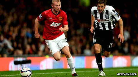 Ryan Tunnicliffe (left) on his first team debut