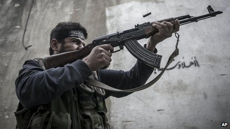 Oct. 24, 2012  A Free Syrian Army fighter from Liwwa Al-Tawhid carries out a military operation in the Karmal Jabl neighborhood, Aleppo, Syria