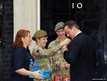 Prime Minister David Cameron buys a poppy