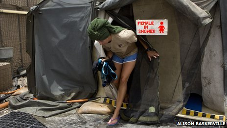 A female soldier exiting a shower tent