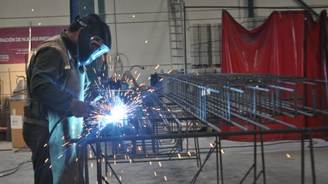 Forma worker welding metal structures for buildings