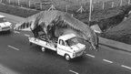 Dinosaur on transit