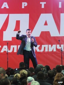 Ukrainian heavyweight boxing superstar Vitali Klitschko gestures during a campaign rally outside Kiev on October 25