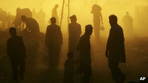 Pakistanis at a livestock market near Islamabad