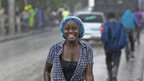 Woman in the rain in the Haitian capital, Port-au-Prince