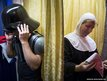 Customers try on Darth Vader and nun costumes