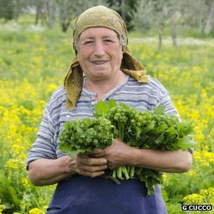 Woman holding broccola in Campagnia