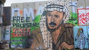 Graffiti depicting the late Palestinian leader Yasser Arafat