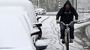 Cyclist in the snow in Den Bosch, Netherlands - file pic