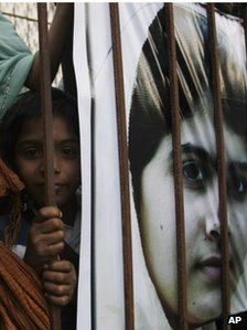 A Pakistani girl with a banner of Malala Yousafzai at a demonstration in Karachi