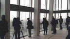 Media from around the world see the view for the first time from the 69th floor