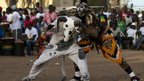 Traditional performers dressed up as a ram and lion at the final of the final of the Senegalese TV show Khar Bii - Saturday 20 October 2012