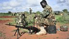 A Ugandan African Union soldier cleaning a weapon in Somalia - Friday 19 October 2012