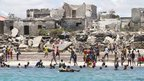 People swimming and relaxing on Lido beach in Somalia - Friday 19 October 2012