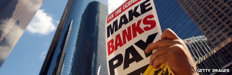Anti-bank leaflet held aloft in downtown Manhattan