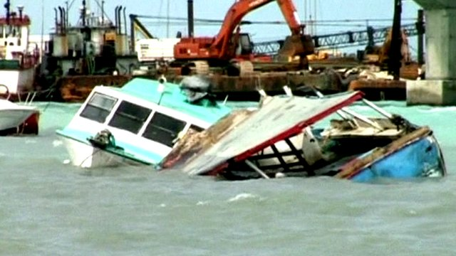 Damaged boats floating in waters in Nassau