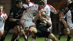 Iain Henderson charges through the Dragons defence as Ulster extend their unbeaten competitive run to eight matches