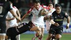Tommy Bowe in action for Ulster as Jonathan Evans prepares to tackle the full-back
