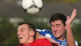 Lisburn Distillery's Michael Halliday battles with Dungannon's Cameron Grieve