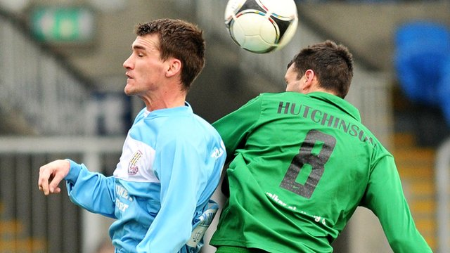 Match action from Ballymena United against Ballinamallard