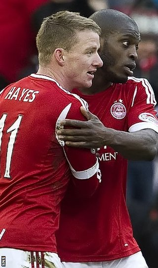 Hayes is congratulated by Isaac Osbourne after scoring at Pittodrie