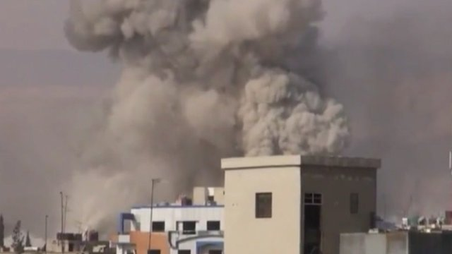 Smoke rises over Douma