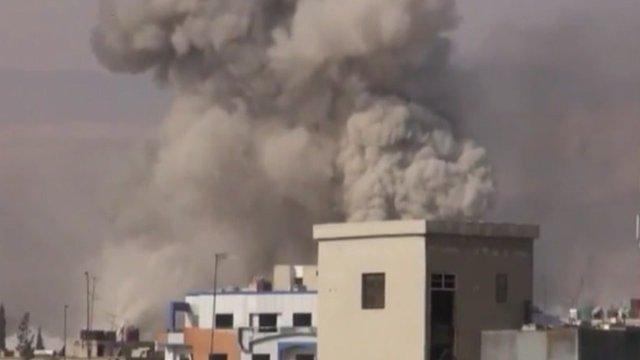Smoke rises over Douma