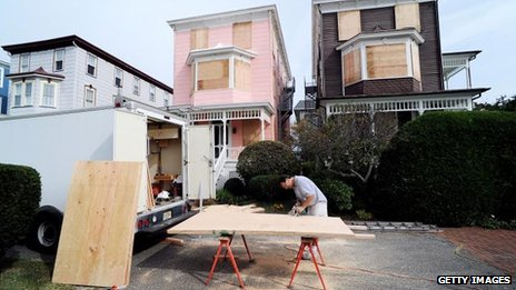 A resident of New Jersey boards up in preparation for Hurricane Sandy, 27 Oct