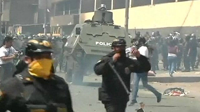 Police and protesters on the streets of Lima, Peru