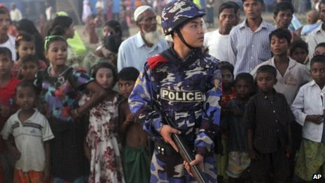 Armed policeman guards refugees at camp in Sittwe - 27 October